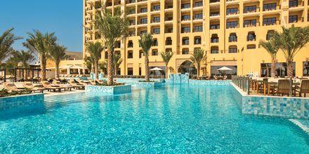 Poolområdet på hotel Doubletree by Hilton Marjan Island i Ras al Khaimah, De Forenede Arabiske Emirater.