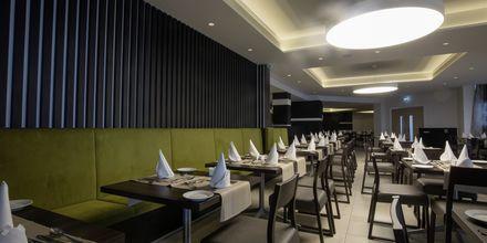 Restaurant på Hotel Evalena Beach i Fig Tree Bay, Cypern.