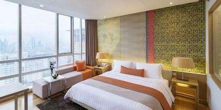 Deluxe-værelse på Hotel Pathumwan Princess i Bangkok, Thailand.