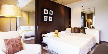 Familie-værelse på Hotel Pathumwan Princess i Bangkok, Thailand.