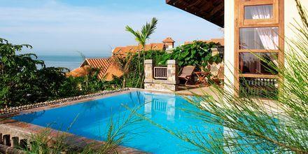Deluxe-værelse i bungalow på Hotel Romana Resort i Vietnam.