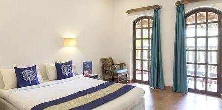 Deluxe-værelse på Ruffles Beach Resort, Det Nordlige Goa, Indien.