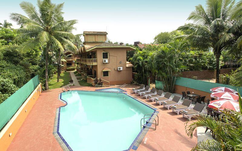 Poolområde på Ruffles Beach Resort, Det Nordlige Goa, Indien.