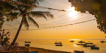 Solnedgang fra restaurant i Sanur på Bali.